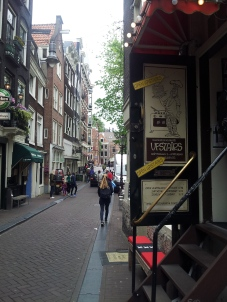 A lovely street, with the entrance to a delicious crêpe café called Upstairs Pancake House in the forefront.