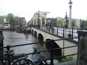 A bridge stretching across a particularly wide canal.